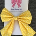Yellow Hair Bow with white Polka dots