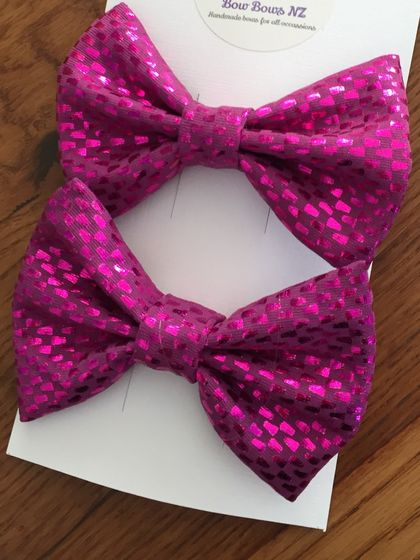 Two Small Pink Sparkly Bows