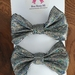 Two small sparkly silver bows