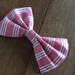 Medium size red with white strip bow
