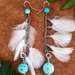 Long dangly white Kereru feathered earrings
