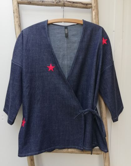 Denim wrap top with red stars