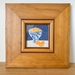 Hand embroidered art work in square wooden frame