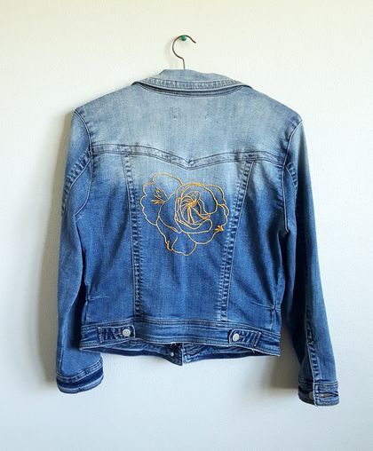 Hand embroidery on denim jacket
