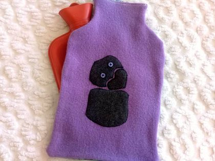 Purple and black tiki hot water bottle cover