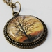 New Zealand silhouette tree photo pendant necklace in antique brass cabochon