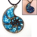 Wooden Nautilus shell pendant necklace with crushed shell inlay and glow-in-the-dark outline