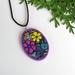 Oval vibrant flower pendant, purple