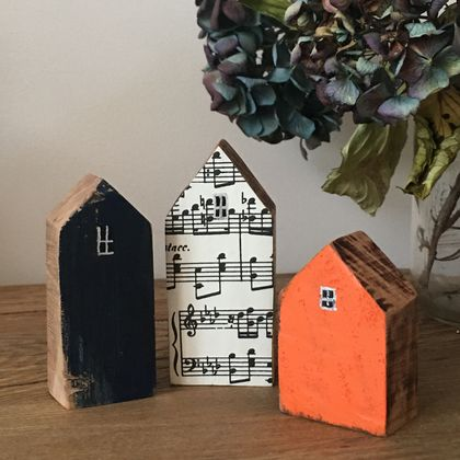 Little dwellings made from recycled wood. A pop of colour.