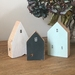 Little dwellings made from recycled wood. White, pale green and dark grey.