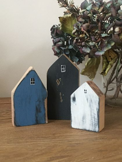 Little dwellings made from recycled wood.