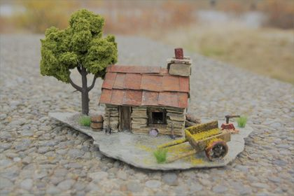 Miniature Stone Cottage with Cart and Green Tree