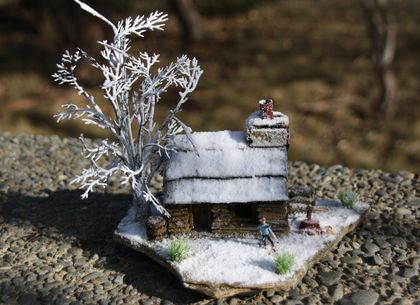 Miniature Stone Cottage with Old Relic's snow effect, featuring winter tree and cross country skier.