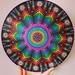 Rainbow dottilism mandala on 12 inch vinyl record