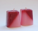 Pair of tapered red and white striped candles