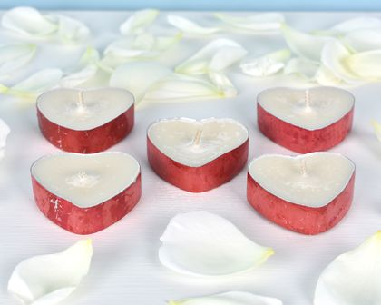 Set of five recycled heart shaped passionflower scented soy tealights